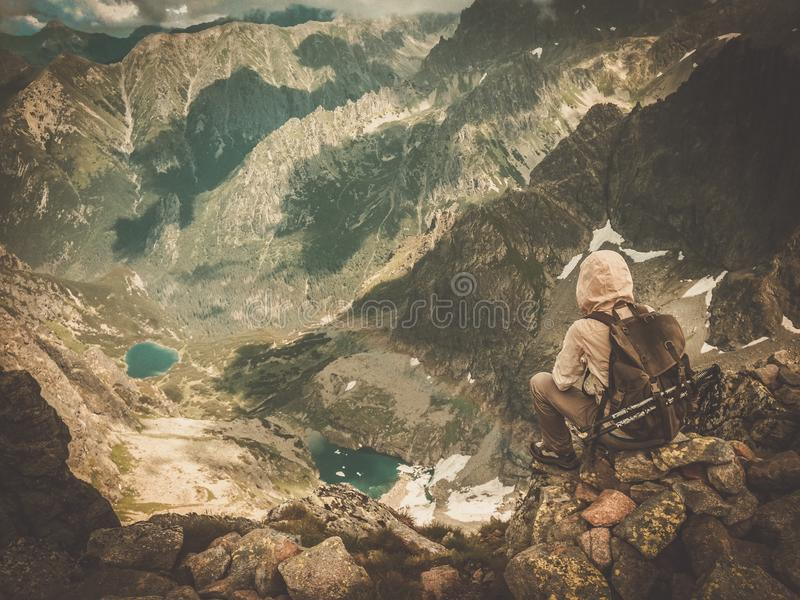 Hiker on a mountain royalty free stock photos