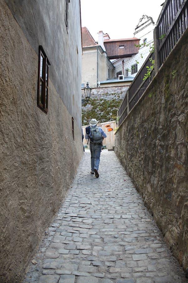 Hiker in Narrow Street stock photo