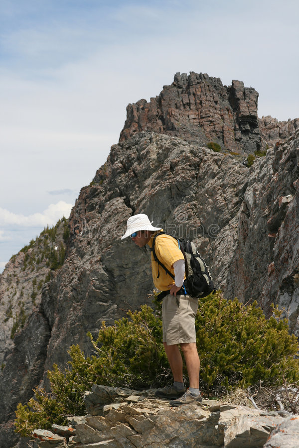 Free Hiker On Edge Of Mountain Royalty Free Stock Images - 2641409