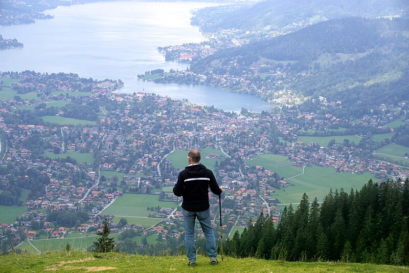 Hiker over coastal city, Bavaria stock image