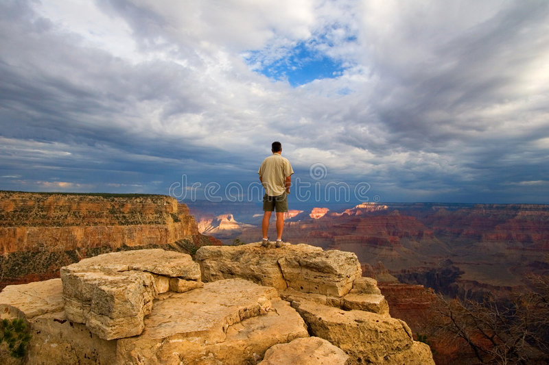 Hiker on Peak in Grand Canyon. Hiker thinking on Peak in Grand Canyon stock photography