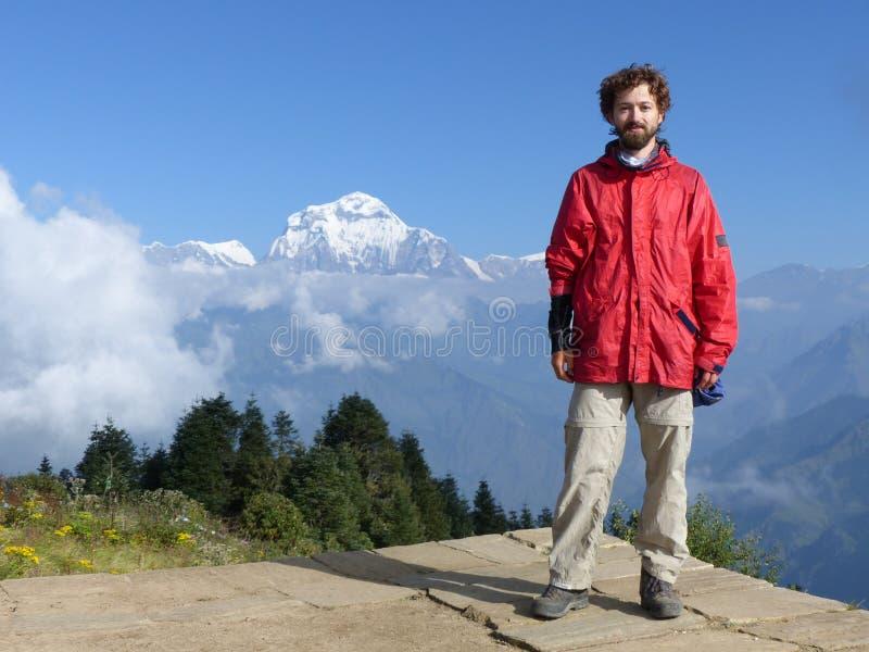 Hiker on Poon Hill, Dhaulagiri range, Nepal royalty free stock photo