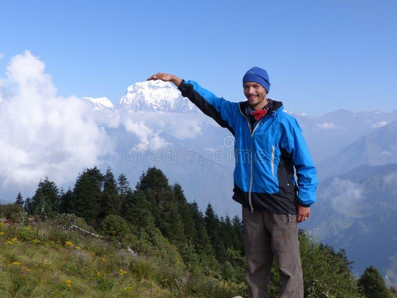 Hiker on Poon Hill, Dhaulagiri range, Nepal royalty free stock photography
