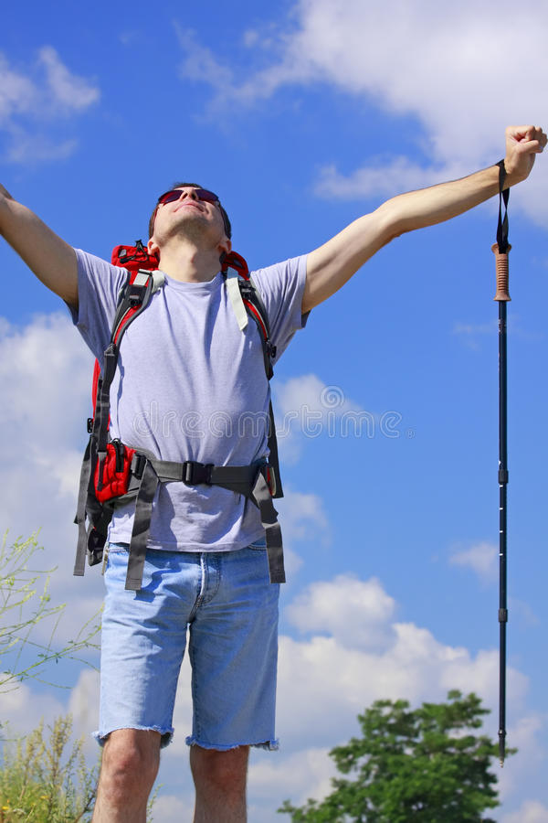 Hiker with raised arms royalty free stock photography