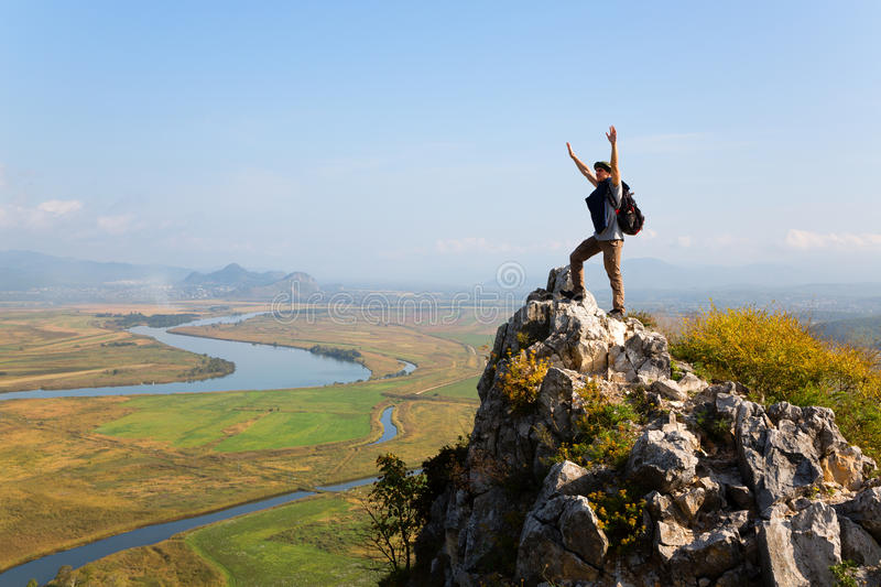 Hiker raises his arms up and screaming with delight royalty free stock images