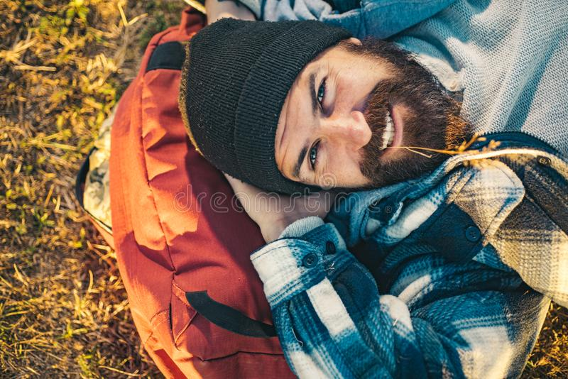 Hiker ready for adventures. Brutal manly guy. Hiker tourist. Nature background. Happy bearded man hiking. Hiker ready for adventures. Brutal manly guy. Hiker stock photo