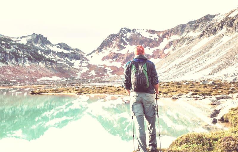 Relaxing on mountain lake stock photos