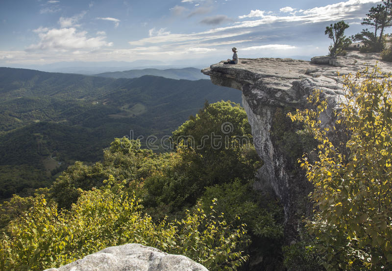 Hiker Resting On An Appalachian Trail Overlook. This is a view of Mcafee Knob a well know Appalachian Trail overlook in Virginia royalty free stock image