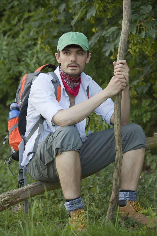 Hiker resting on tree