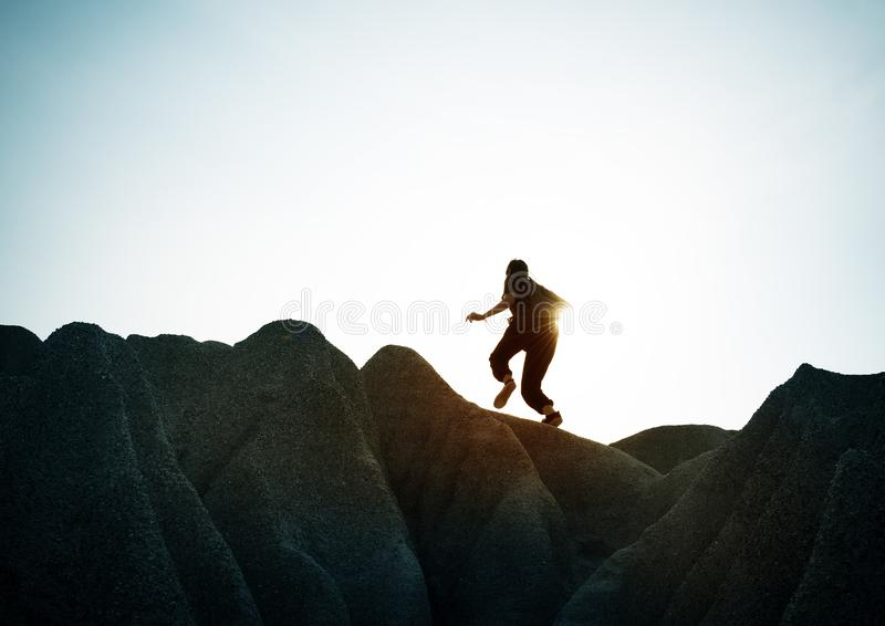 Hiker on rocks stock photography