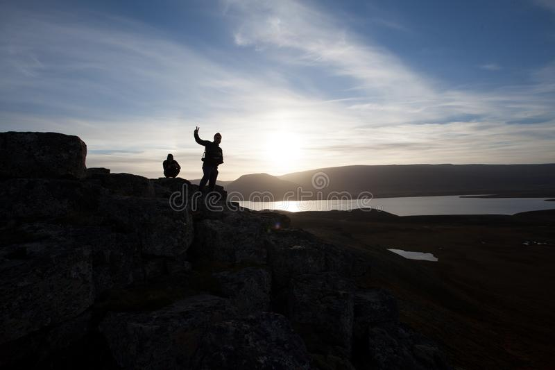 Hiker on a rocky cliff during the sunset. Great atmosphere with stock photos