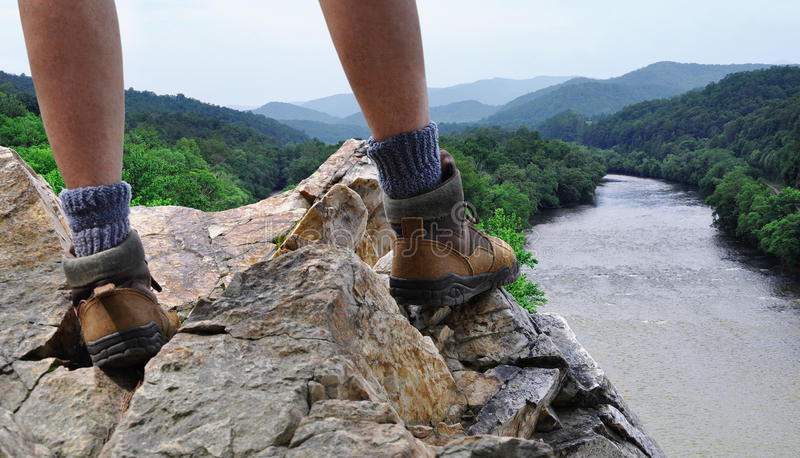 Hiker on rocky summit of mountain royalty free stock image
