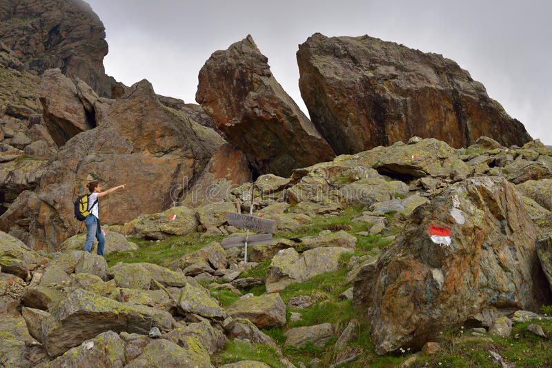 Hiker showing direction stock images