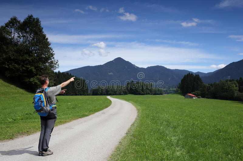 Hiker is showing. To beautiful natural landscape royalty free stock image