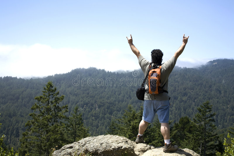 Hiker Shows Sign of Victory stock photography