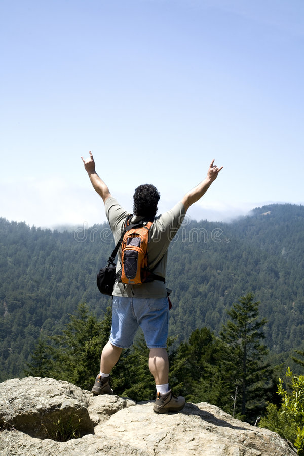 Hiker Shows Sign of Victory royalty free stock images