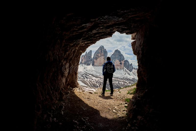 A hiker with Tre Cime di Lavaredo in the background, Dolomites, Italy royalty free stock image