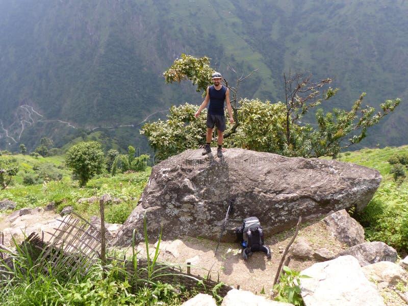 Hiker standing on stone. Marsyangdi river valley - Annapurna Circuit trek in Nepal royalty free stock images