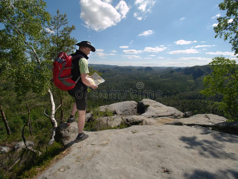 Hiker stay close to edge above forest valley. Travel and hike fashion. Concept, wild, wanderlust, walk, vacation, trip, trekking, tourist, tourism, sunrise stock photos
