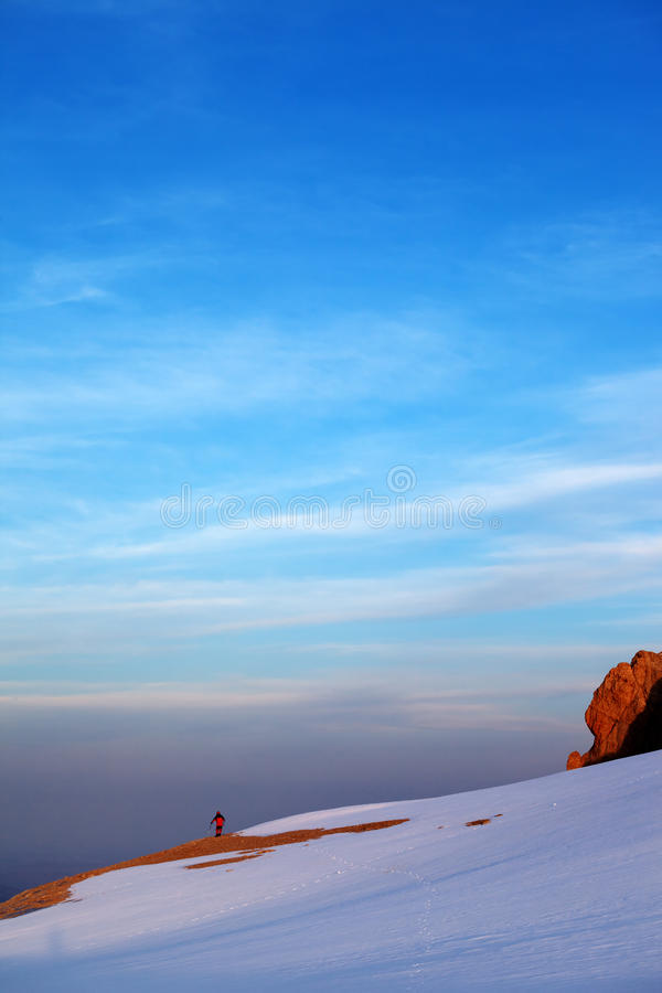 Hiker In Sunrise Snow Mountains Royalty Free Stock Photo