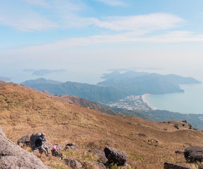 Hiker in Sunset peak at Lantau Island, Hong Kong. Autumn stock photo