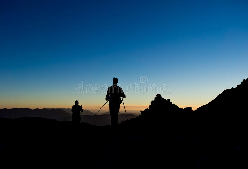 Hiker Sunset Silhouette. Silhouette of two hikers on the Sperry Glacier trail in Glacier national Park at sunset royalty free stock photo