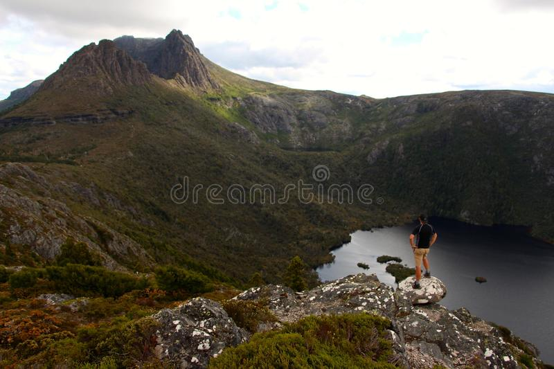Hiker taking in the breathtaking views over cradle mountain royalty free stock photography