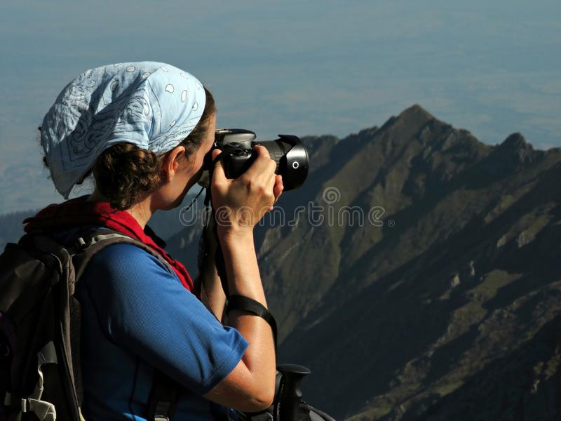 Hiker taking photos in the mountains. Hiker taking landscape photos on the trail stock photos