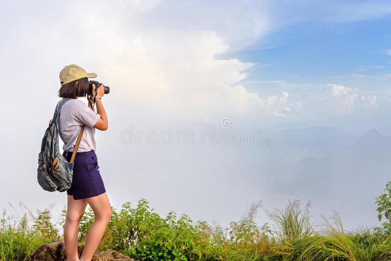 Hiker teens girl taking picture royalty free stock photos