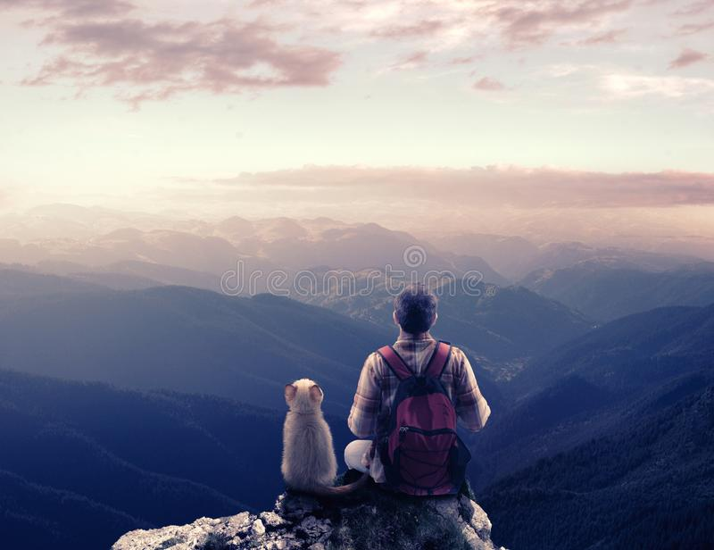 Hiker on top of a mountain royalty free stock image
