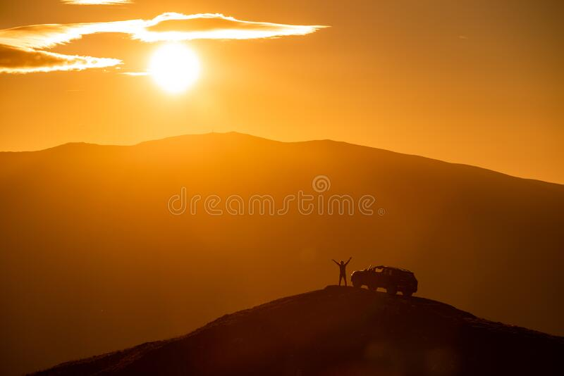 Hiker on the top of the mountains ,off road car adventure in nature at the sunset.  stock image