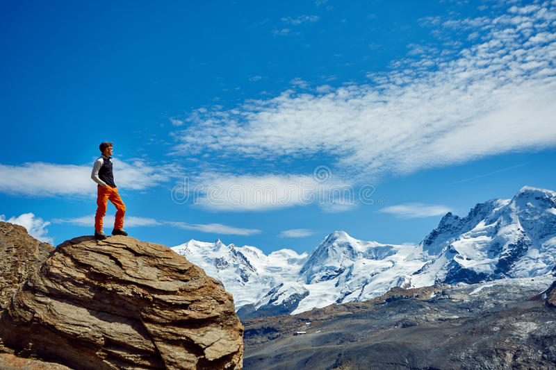 Hiker at the top of a pass stock photography