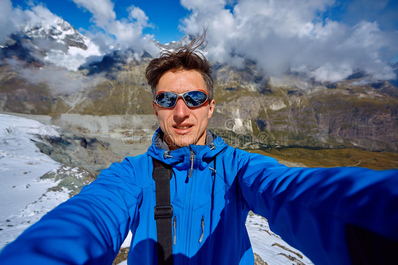 Hiker at the top of a pass royalty free stock photography