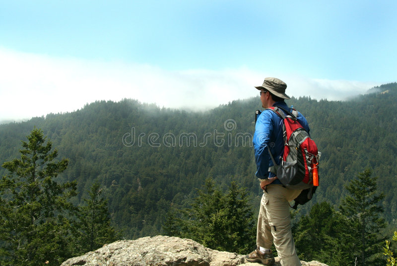 Hiker on Top of a Peak stock photography