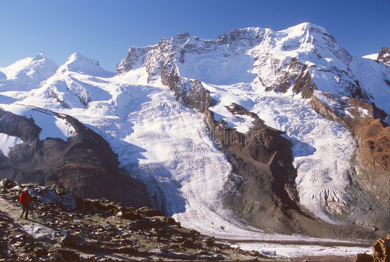 Hiker on trail by Gorner Glacier, Zermatt, Switzerland