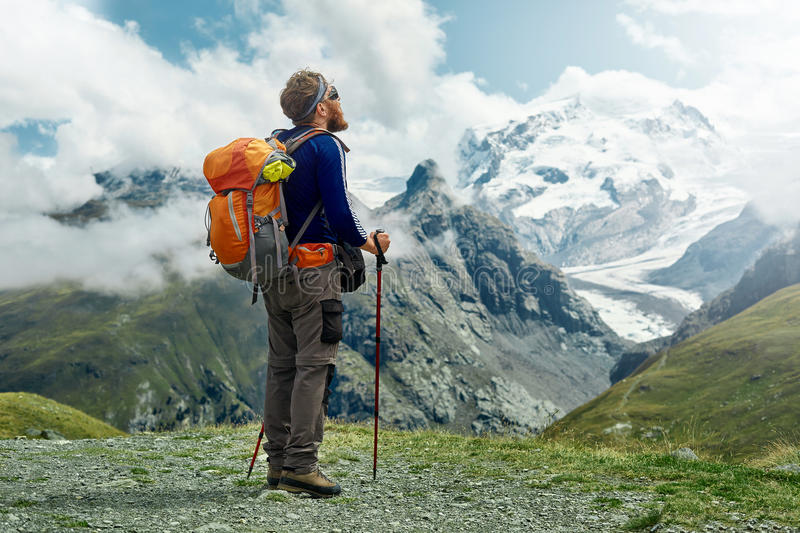 Hiker on the trail in the mountains stock photos