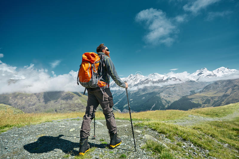Hiker on the trail in the mountains stock photography