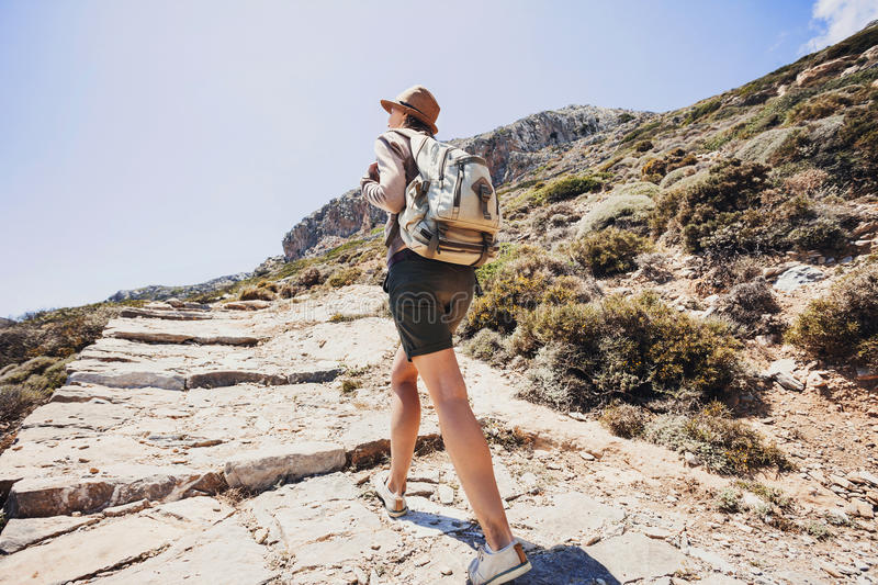 Hiker traveler girl on a hiking trail, travel and active lifestyle concept royalty free stock image
