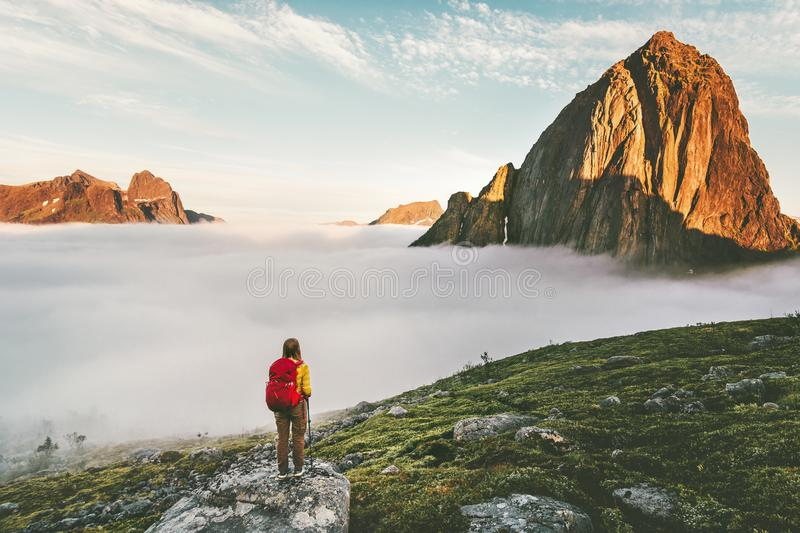 Hiker traveling in sunset mountains with backpack royalty free stock image