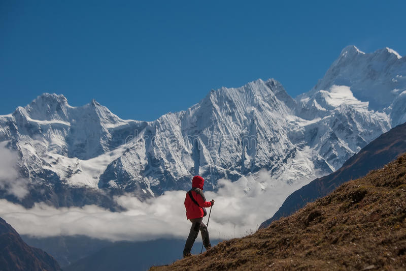 Hiker on the trek in Himalayas royalty free stock photos