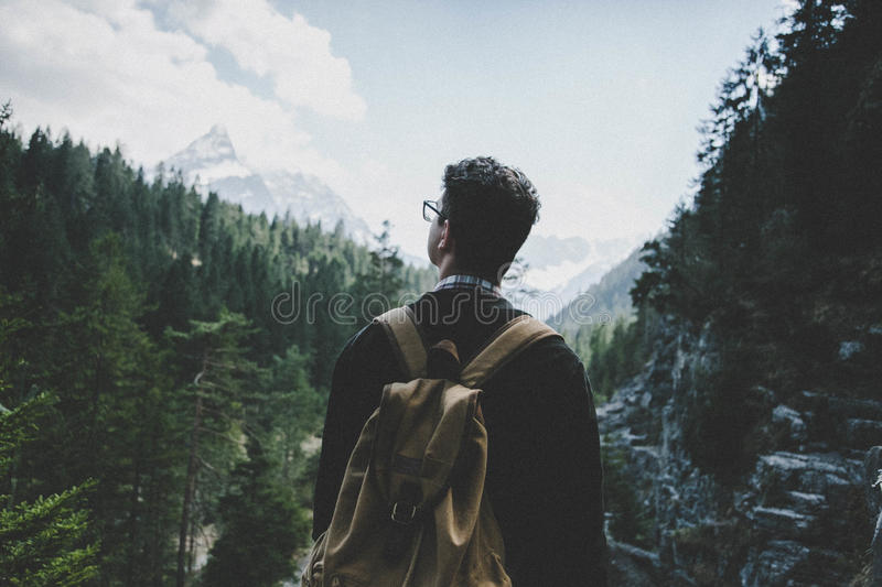 Hiker viewing mountains stock photography