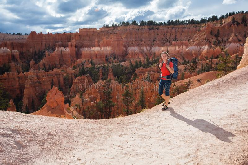 Hiker visits Bryce canyon National park in Utah, USA.  stock images