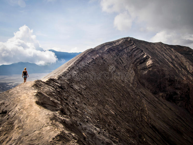 Hiker Walking Around Rim of Gunung Bromo Volcano, Java, Indonesia stock photography