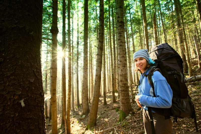 Hiker walking in autumn mountains stock image
