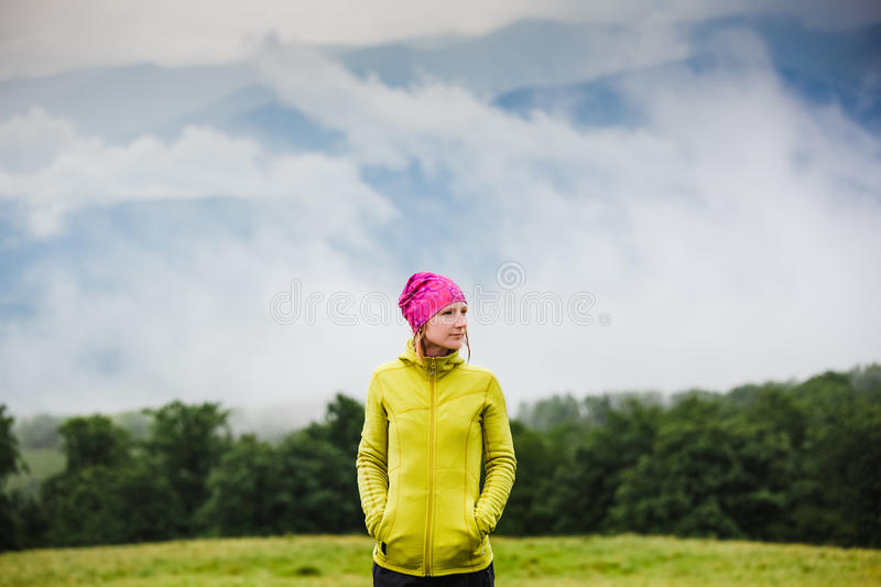 Hiker walking in autumn mountains. And enjoying the view royalty free stock photos