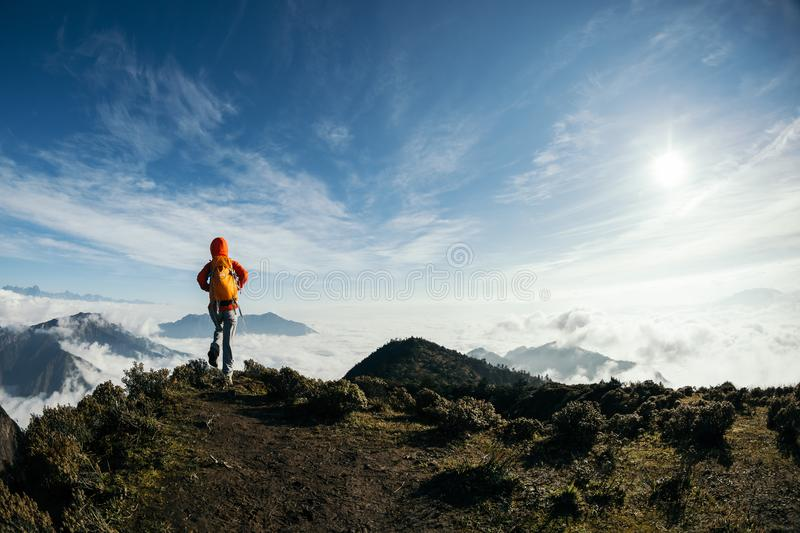 hiker walking in the beautiful landscape on mountain top stock photography