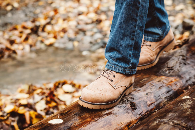 Hiker walking in boots closeup stock photography
