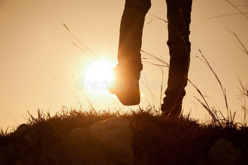 A hiker walking on a path royalty free stock photos