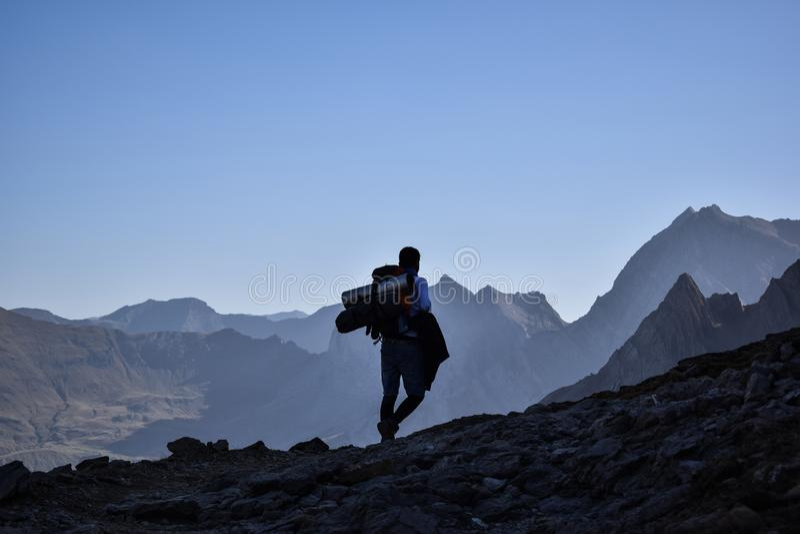 Hiker walking on the ridge of a mountain stock photo