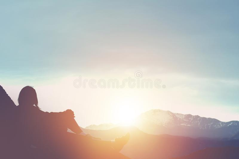 Hiker Watching Sunset. Resting on the Large Boulder. Travel royalty free stock image
